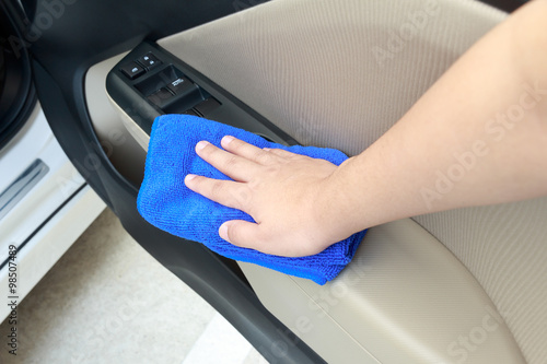 hand cleaning interior car door panel with microfiber. Black Bedroom Furniture Sets. Home Design Ideas