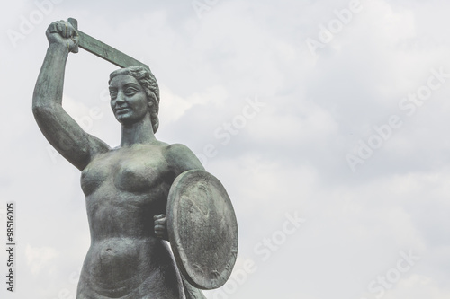 The Warsaw Mermaid called Syrenka on the Vistula River bank in W - 98516005