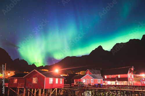 Plexiglas Antarctica Beautiful picture of massive multicoloured vibrant Aurora Borealis, Aurora Polaris, also know as Northern Lights in the night sky over Norway, Lofoten Islands