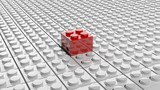 Fototapety Connected white lego blocks with one red standing out, abstract background.