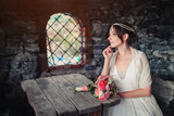 the bride in the castle at a wooden table