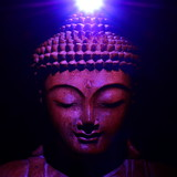 Buddha face with light