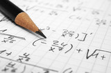 Maths concept - macro of a pencil over a sheet of paper with maths-formulas - 98638482