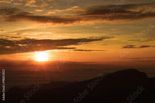 Papiers peints Orange eclat Beautiful sunset at the mountains. Colorful landscape with sun and
