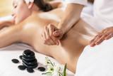Fototapety Woman enjoying massage.