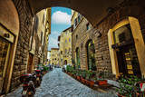 Fototapety View of the  street and old medieval houses at historic center o