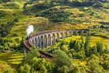 Fototapety Glenfinnan Railway Viaduct in Scotland with a steam train