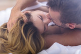 Fototapety Married couple kissing in bed
