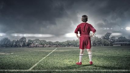 kid boy on soccer field © Sergey Nivens