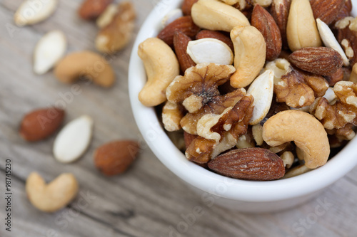 Bowl of Mixed Nuts on Rustic Wooden Table