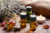 Fototapety essential oils with candle and herbs