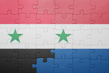 puzzle with the national flag of netherlands and syria
