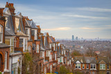 Traditional British brick houses on a cloudy morning with east London at background. Panoramic shot from Muswell Hill, London, UK
