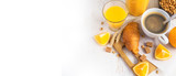 Croissants, coffee and orange juice, top view. Breakfast concept