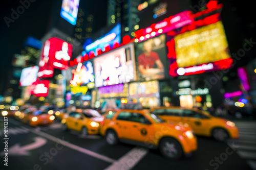 Foto op Plexiglas New York TAXI Defocus view of Times Square signage, traffic, and holiday crowds in the lead-up to New Year's Eve in New York City, USA
