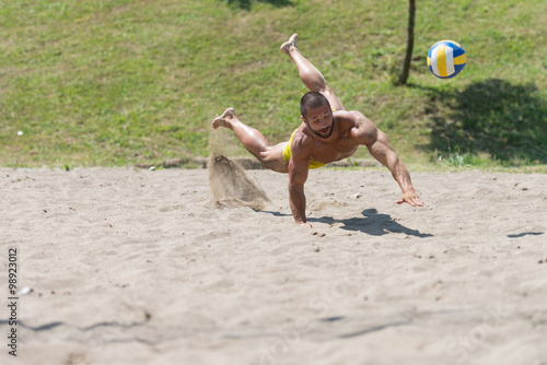 Male Beach Volleyball Game Player Jump On Sand Poster