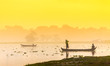 MANDALAY - FEB 19 : Fisherman throw net for catching fish in Tau