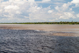 The Meeting of Waters (Encontro das Aguas) is the confluence between the Rio Negro river, with dark water, and lighter Amazon river or Rio Solimoes