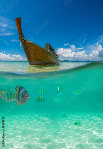 Poster Underwater picture with fish and traditional longtail boat in Ma