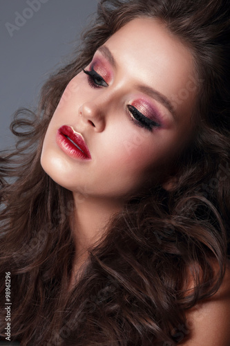 Poster Portrait of a young woman, close-up, bright makeup, eye shadow.