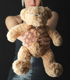 Portrait of Teddy bear and atractive woman