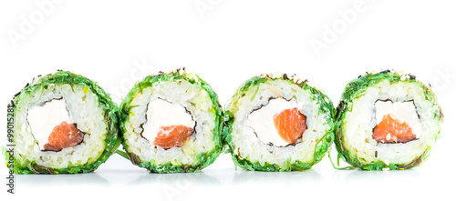 Fototapeta close-up of traditional fresh japanese seafood sushi rolls on a