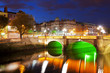 Dublin at night down by the Liffey River - 99062624