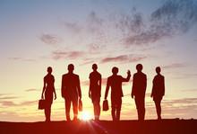 Teamwork on dawn background