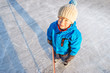 Winter time. Young boy playing ice hockey on an outdoor ice rink.  Overhead view