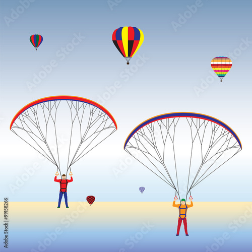 Fototapeta Paragliding and balloons in the sky.