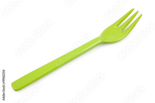 Green plastic forks isolated on white background