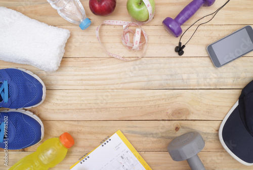 sports, concept of weight loss : Sport shoes and water with set for sports activities on tiled floor
