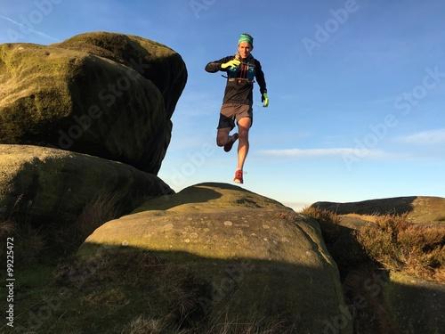 Fototapeta Fell runner on mountain trail