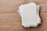 Fototapety Stack of old envelopes and letters on kraft paper, top view