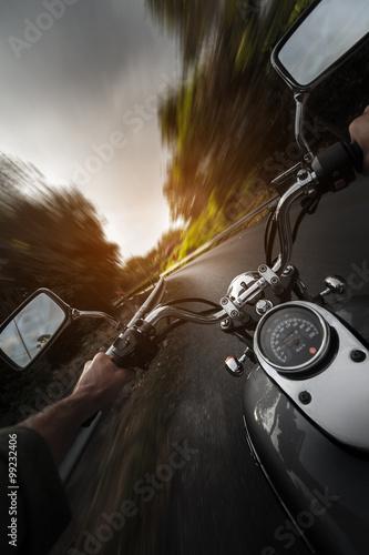 Motorcycle on the empty asphalt road canvas