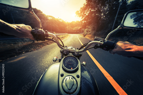 Motorcycle on the empty asphalt road плакат