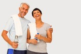 Fototapety Composite image of portrait of a happy fit couple