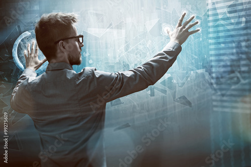 Man works on a Touchscreen Interface