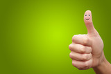 Happy cheerful smiley finger on green background