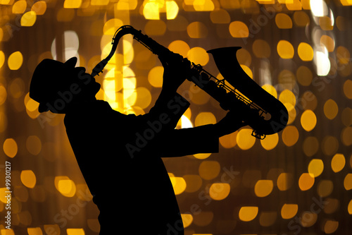 Poster Saxophonist. Man playing on saxophone