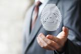 Businessman pressing modern web technology panel with fingerprint print
