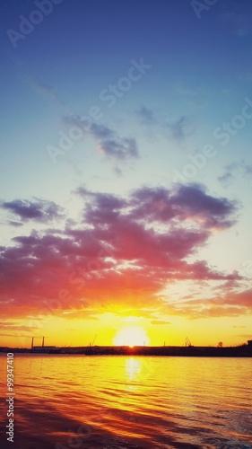 Sunrise over the sea port