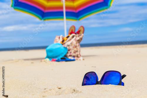 Sunglasses gadgets sunbathers background © Yotka