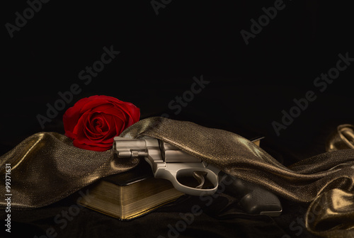 Poster Handgun resting on a Book with a Red Rose