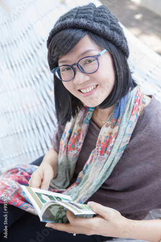 portrait of beautiful asian woman relaxing time reading book on