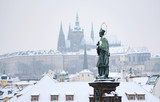 Prague Castle in Winter, View from Charles Bridge, Stone Statue on Charles Bridge in Foreground