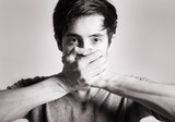 """Speak no evil concept - face of asian man covering his mouth. 99598851,Silhouette of pregnant woman."""""""