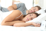 Fototapety Couple sleeping in a comfortable bed