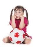 Little girl football player.