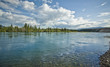 flowing yukon river near whitehorse, canada